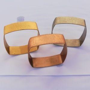 3 brushed metal bangles